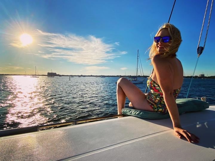 beautiful woman on catamaran in miami