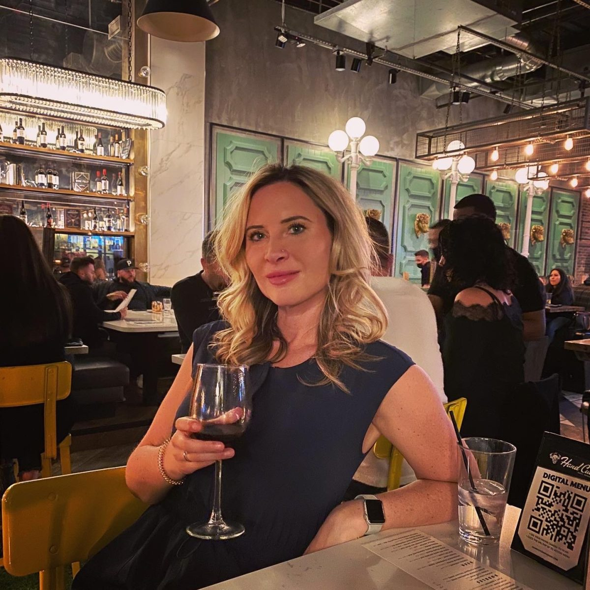 beautiful blonde woman with a glass of wine